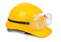 Yellow hard hat and goggles Stock Photos