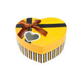Yellow heart shaped box in shape on white background Stock Images