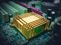 Yellow heat sink on the motherboard is used to cool microprocessors Royalty Free Stock Photo
