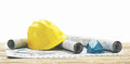 Yellow helmet with building projects and house Royalty Free Stock Photo