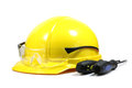 Yellow helmet with screwdrivers on a white background Royalty Free Stock Image