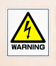 Yellow high voltage warning sign Stock Image