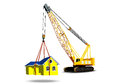 Yellow house with a crane keeps the on weight Stock Image
