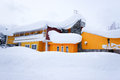 Yellow house in snow a model achitecture Royalty Free Stock Image