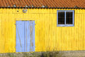 Yellow hut brightly painted used by oyster fishermen Stock Image