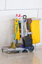 Yellow janitor cart with cleaner equipment Stock Image