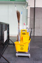Yellow janitor cart outside office Royalty Free Stock Photos