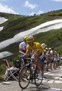 Yellow jersey daryl impey col de pailheres france july the south african cyclist from orica greenedge team climbing the road to Stock Photo