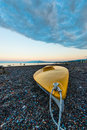 Yellow kayak on the beach boat city of psaropouli island evia greece Royalty Free Stock Photo