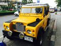 Yellow land rover old Stock Image