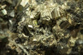 Yellow lead zinc ore closeup macro picture of and black iron with irregular texture Royalty Free Stock Photo