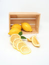 Yellow lemon and wood box Royalty Free Stock Photo