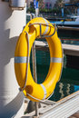 Yellow life buoy on the sea pier Royalty Free Stock Photo