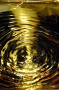 Yellow Light Reflecting On Water Ripples or Waves Royalty Free Stock Photo