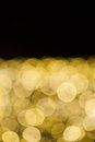 Yellow lights bokeh background with black copy space Royalty Free Stock Image