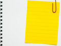 Yellow line memo paper clipped on white notebook Royalty Free Stock Photo
