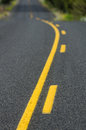Yellow lines on rural roadway traffic control a Stock Photos