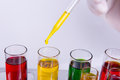 Yellow liquid dripping from pipette into test tube Royalty Free Stock Photo