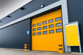 Yellow loading door in a storage building Stock Image