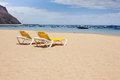 Yellow lounge chairs on the sea beach vacation concept white sand shore of ocean Stock Photo