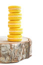 Yellow macarons tower on a stump Royalty Free Stock Photo