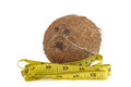 Yellow measuring tape and coconut the concept of diet health Royalty Free Stock Photos