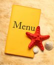 Yellow menu book and seashells seastar Stock Photo
