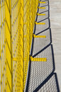 Yellow metal barrier netting Royalty Free Stock Photo
