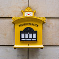 Yellow Metal Old Mailbox Stone Wall Traditional 1800 German Dres Royalty Free Stock Photo