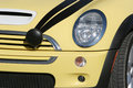 Yellow Mini Cooper car Stock Images