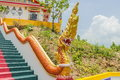 Yellow Naka (giant snake) statue on top of main stair leading to the replica of Phra That In-Kwaen (Hanging Golden