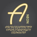 Yellow neon alphabet and numbers vector set of Royalty Free Stock Photos