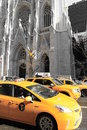 Yellow new york taxis outside st patrick s cathedral march city iconic is a popular place of worship and a Stock Images
