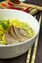 Yellow noodles delicious on wood floors Royalty Free Stock Photos