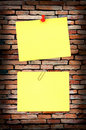 Yellow note on old brick wall Royalty Free Stock Photo
