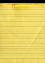 A yellow note pad with ripped off papers Royalty Free Stock Image