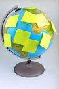 Yellow notes on Earth globe Royalty Free Stock Photography