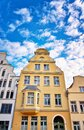 Yellow old gabled house facade with bay window in the old town of Wismar Royalty Free Stock Photo
