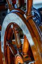 Yellow, old, lacquered, wooden steering wheel on the sea yacht, Royalty Free Stock Photo