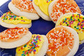 Yellow and Orange Frosted Sugar Cookies with Sprin Royalty Free Stock Photography