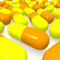 Yellow and orange pills Stock Photo