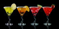 Yellow, orange, pink and red martini drinks Royalty Free Stock Image