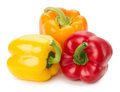 Yellow orange and red peppers isolated on the white background Stock Photos