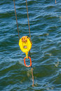 Yellow and orange turnbuckle over sea with cabler Stock Photo