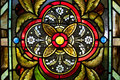 Yellow orb centered within four circles view of church stained glass window with with leaves Stock Photos