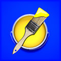 Yellow paint with wet paint brush over a contrasting colored blue background Stock Photos