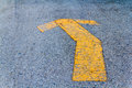 Yellow painted arrow indication of the road photo surface Royalty Free Stock Image