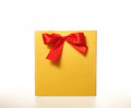 Yellow paper gift bag with a Red Ribbon on white background Royalty Free Stock Photo
