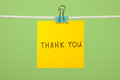 "Yellow paper note on clothesline with text ""Thank You"" Royalty Free Stock Photo"
