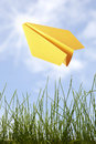 Yellow paper plane in the sky Royalty Free Stock Photos